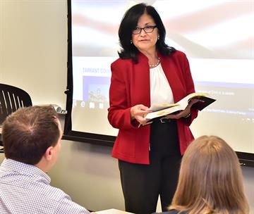 Prof Contreras teaching with students