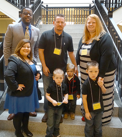 Texas A&M School of Law students Adrian Jackson and Amanda Martinez with the Tarwarter family at National Adoption Day in Tarrant County
