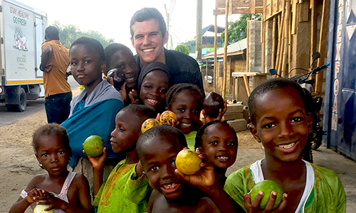 Taylor Winn with children in Ghana