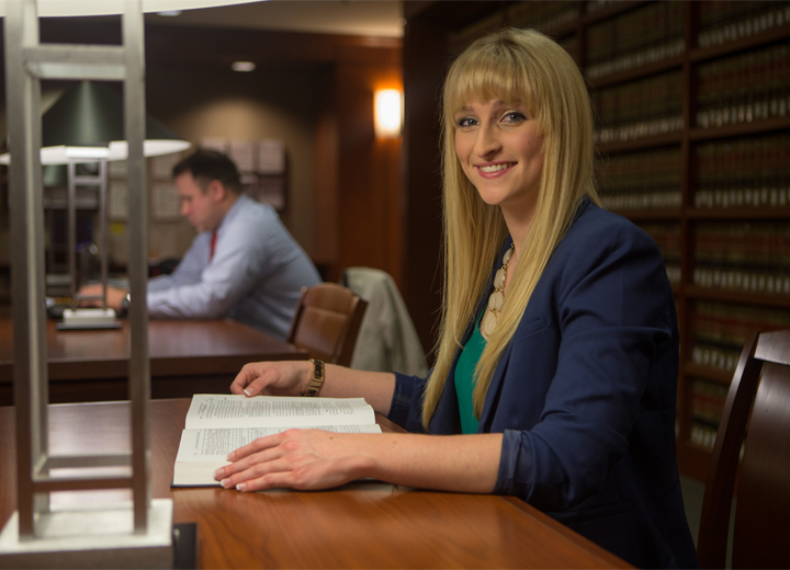 Texas A&M School of Law student in library