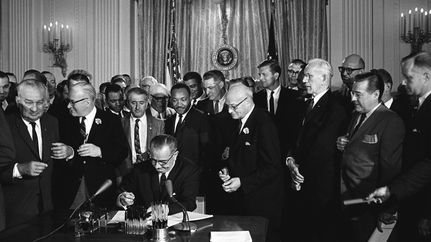 Johnson signs Civil Rights Act of 1964